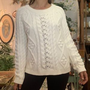 Knitted and knotted chunky white knit sweater